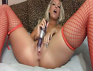 Blond Haired Nympho In Red Fishnet Stockings Uses Dildo To Pet C