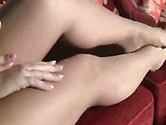 Hot Girl Petra Sitting On The Cozy Couch And Massaging Her Feet