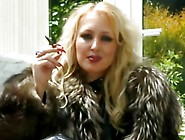 Blonde Mistress In Fur Smokes