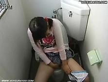 Pigtailed Schoolgirl [:] Fingering On The Toilet