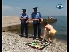 Russian Cops Harass Nude Sunbather