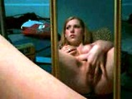 Pierced Pussy Masturbates Using A Mirror