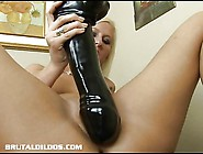 This Blonde Inserts A Massive Brutal Dildo In Her Wet Pussy