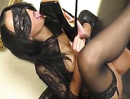 Big Breasted Brunette In Sexy Lingerie Inserting A High Heel Sho