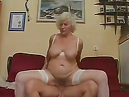 Busty Granny Gives Head To Young Stud And Rides His Cock