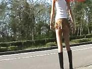 Aya Walking Around With Ripped Up Skirt Near Road