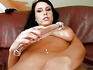 Big Tit Hottie Shoves Huge Glass Dildo In Pussy