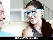 Slim Brunette With Huge,  Blue Glasses Is Kneeling On The Floor A