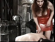 A Dominant Redhead Doles Out Some Cruel Punishment To A Tied Up