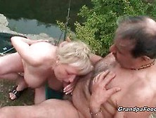 Blond Mature Babe Giving A Blowjob Outdoors