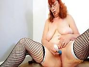 Saggy Mature Titties On This Masturbating Redhead