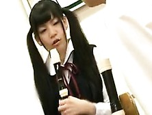 Cute Asian Teen In Pigtails Practices The Flute With Her Te