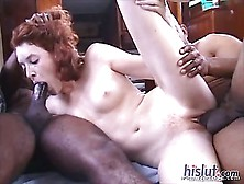Redhead Jesmi Lynn Gets Two Black Rods