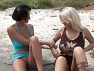 These Hot And Horny Lesbians Lick And Fuck Each Other On The Bea