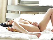Ravishing Brunette Beauty Lies On The Bed And Makes Herself Cum