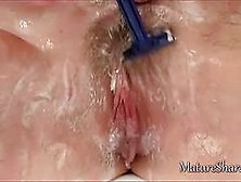 Mature Woman Showering And Pissing