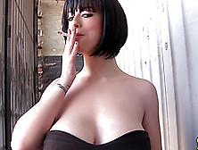 Hot Short Haired Brunette Backstage Having A Quick Smoke