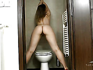 Hot Naked Milf In Heels Pisses In The Toilet
