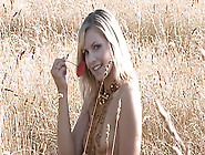 Blonde Teen Poses Naked In A Field