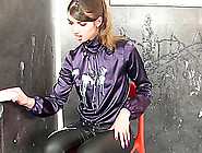 Beautiful Solo Woman In A Satin Blouse Surprised At A Gloryhole