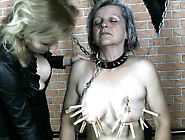 Mature Mistress Ties Up Her Slave And Uses Clothespins To Tortur