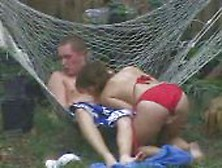 Brother And Sister On Hammock