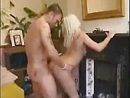Bleach Blonde Gives A Blowjob To Two Guys At Once