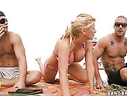 Busty Slutty Ingrid Swenson Seduces Two Men On The Beach And Win