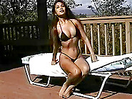 Long Haired Swimsuit Model Posing Outdoors For Your Pleasure