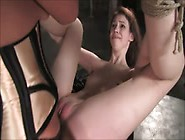 Brunette In Bondage Gets Fucked With A Strapon