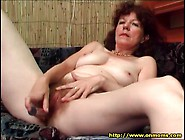 Mature Masturbates Hairy Cunt With Toy