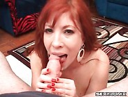Redhead Milf With Arousing Big Tits Gives A Handjob