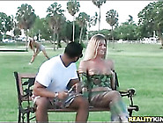Hot Blonde In Body Paint In A Public Park