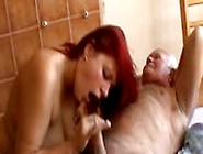 Young Redhead Woman With Old Man