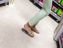 Candid Feet Painted Toes In Flip Flops