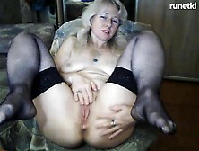 Mature Stockings Uses Toy To Masturbate