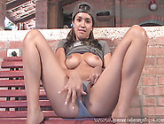 Dark-Haired Chick Touches Her Trimmed Pussy