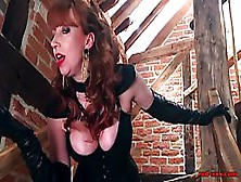 Red Haired Mistress Is Wearing Black,  Leather Corset And Fishnet Stockings While Playing With Pussy