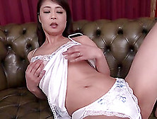 Mature Asian Wife Ootomo Izumi Stripping And Masturbating On The Sofa