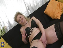 Older Lady In A Leather Bra And Sexy Boots Plays With Her Cunt