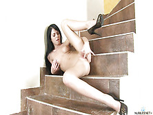 Dark Hair Girl With High-Heels In Solo Action